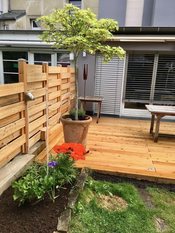 Jardinier au Luxembourg construction abri de jardin bois 47